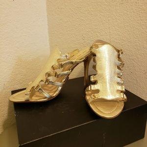 Gold L.A.M.B high heels.